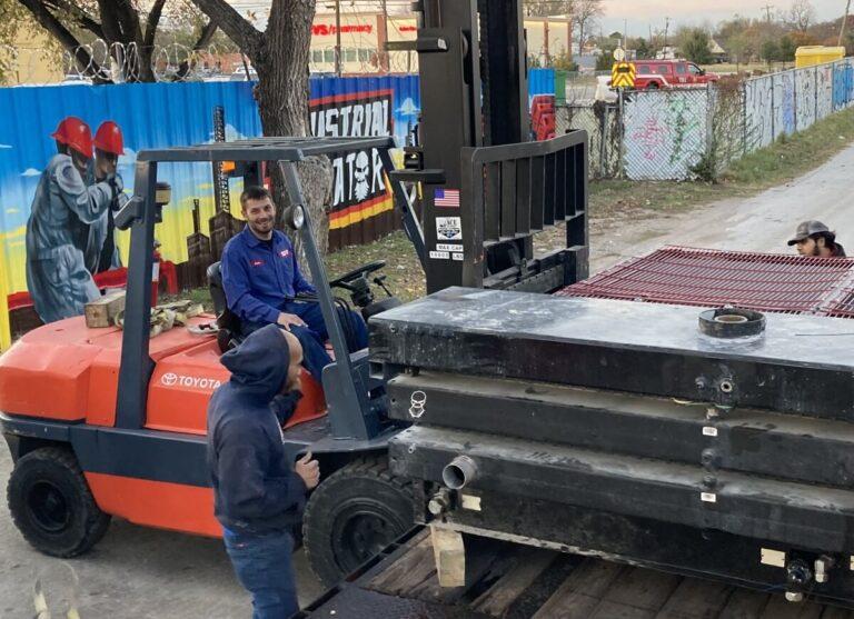 Industrial Radiator Service Manager Seth Copeland unloading a repair job